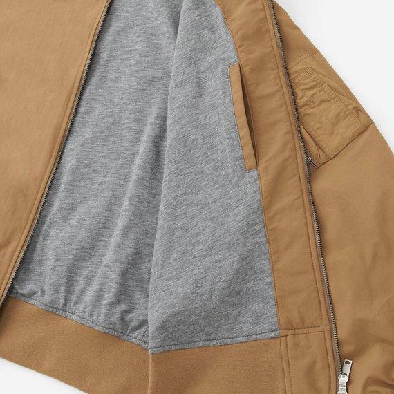 Túi trong áo bomber Uniqlo màu nâu